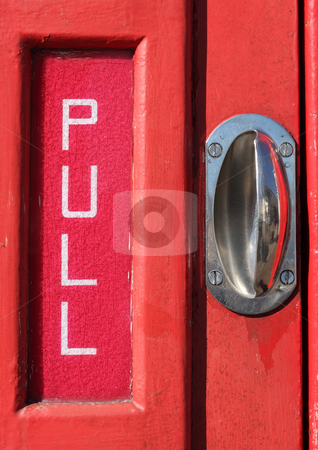Pull sign and handle on a red telephone kiosk door. stock photo, Pull sign and handle on a red telephone kiosk door. by Stephen Rees