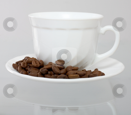 Coffee set stock photo, Cup and saucer whith grain coffee costing on glass by Alexey Romanov