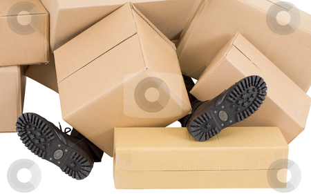 Male feet and heap of boxes stock photo, Male feet sticking out from under heaps of boxes by Alexey Romanov