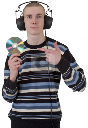 The young guy with ear-phones and a compact disk stock photo, The young guy with ear-phones on a head and a compact disk in a hand by Alexey Romanov