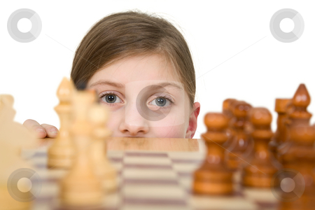 Girl looking chess stock photo, Girl looking chess on the white background by Alexey Romanov