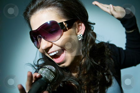 Girl Singing stock photo, Girl Singing by Andrey Zyk