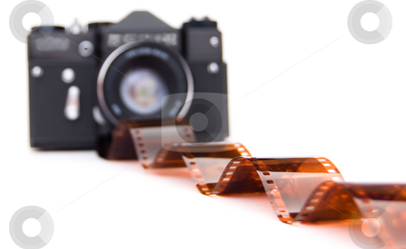 Old camera with photoes and negative film stock photo,  by Vitaly Gariev