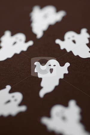 Party of ghosts stock photo, Small plastic halloween ghosts pictured with a narrow depth of field by Stephen Gibson