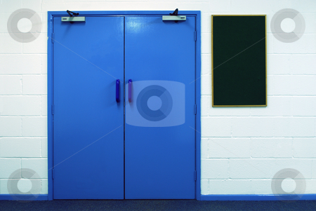 The Double Doors stock photo, Blue double doors against white brick wall with board by Paul Inkles