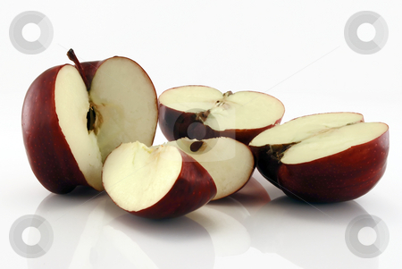 Apples stock photo, Chopped red apples on reflective background against white by Paul Inkles
