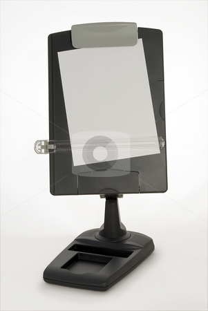 Copy Stand stock photo, Dark grey copy stand with blank piece of paper providing copy space and clipping path supplied by Paul Inkles