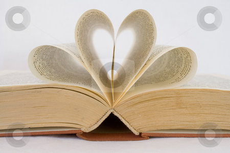Opened book stock photo, Pages of a book curved into heart shapes by ojal_2