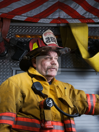 Firefighter Portrait stock photo, Firefighter Portrait in Turnout Gear in front of Apparatus by Jim DeLillo