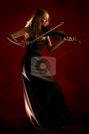 Girl playing the violin stock photo,  by Dmitry Skutin