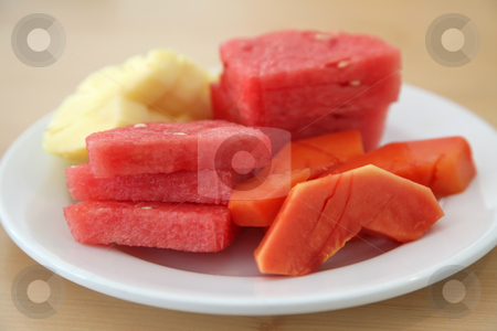 Sliced tropical fruits stock photo, Slices of tropical fruits on plate: watermelon, pineapple, papaya by Kheng Guan Toh
