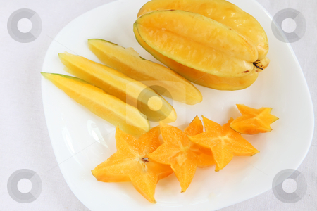 Sliced starfruit stock photo, Sliced starfruit, exotic tropical fruit plate arrangement by Kheng Guan Toh