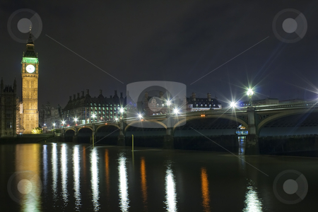 The Big Ben and Westminster Bridge at night stock photo, The Big Ben and Westminster Bridge at night with reflections in the river Thames by Karel Miragaya