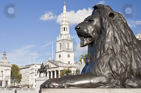 Statue of a lion in Trafalgar Square in London stock photo, Statue of a lion in the Nelson column in Trafalgar Square in London by Karel Miragaya