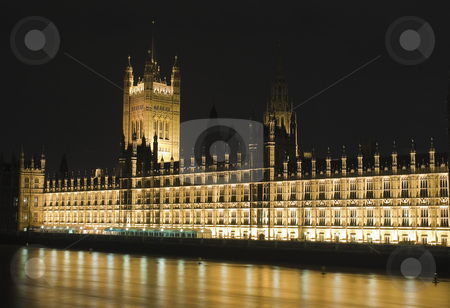 The Houses of Parliament illuminated at night stock photo, The Houses of Parliament in London illuminated at night by Karel Miragaya
