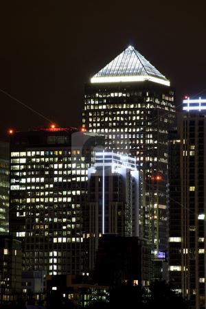 Canary Wharf illuminated at night stock photo, Canary Wharf skyscrapers in London illuminated at night by Karel Miragaya