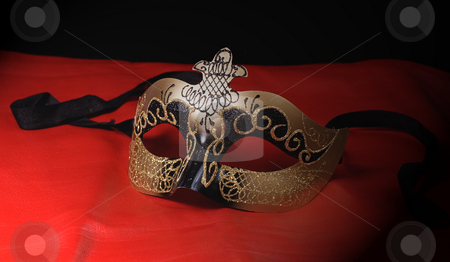 Halloween Mask stock photo, An intricate venetian mask shot on red leather by Richard Nelson