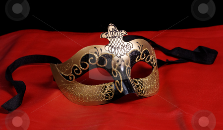 Venetian Mask On Red stock photo, An intricate venetian mask shot on red leather by Richard Nelson