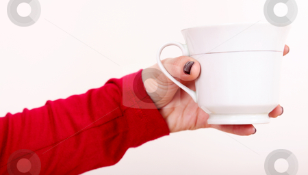 Cup and hand stock photo, Woman hand with cup over white background by Giuseppe Ramos