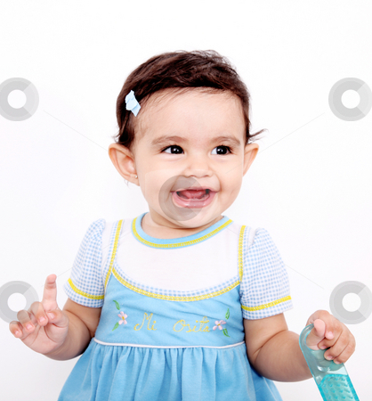 Happy baby stock photo, Happy Baby looking at camera with brush in her hands by Giuseppe Ramos