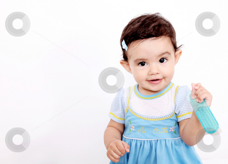 Baby smiling stock photo, Baby looking at camera with brush in her hands by Giuseppe Ramos