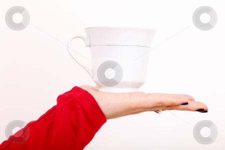Cup stock photo, Woman hand with cup over white background by Giuseppe Ramos