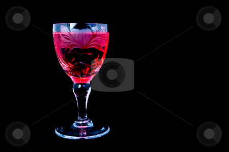 CrystalGlass stock photo, Crystal engraved glass with red wine on a black background by Ian Genis