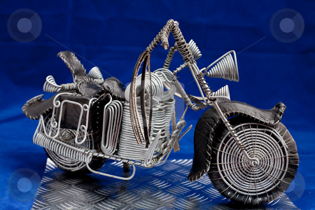 Cruiserbright stock photo, Hand made wire frame easy rider on blue background right view by Ian Genis