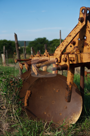 No more ploughing stock photo, A tractor pulled plough standing in the veld weathered and unused by Ian Genis