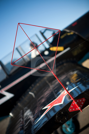 Crosshair stock photo, Horizon reference crosshair on the wingtip of a yak aerobatic aircraft by Ian Genis
