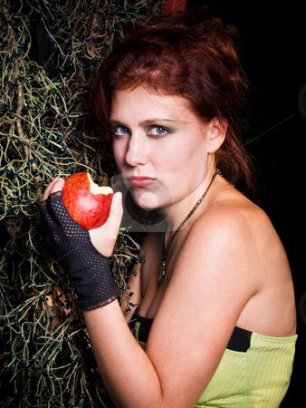 Temptress stock photo, Red headed young woman with a tempting apple by Jim DeLillo
