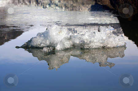 Artic Reflections stock photo, A small iceberg floats in Mendenhall Lake, Juneau Alaska by Mike Dawson