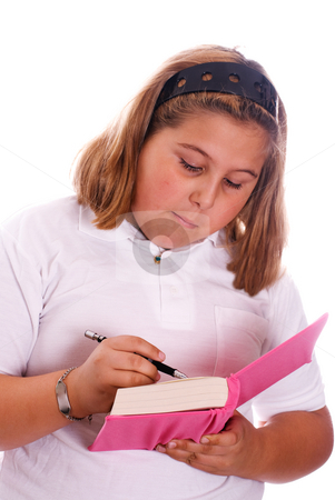 Girl Writing In Diary stock photo, A young girl writing in her pink diary, isolated against a white background by Richard Nelson