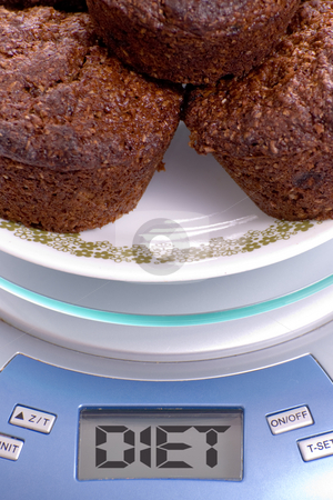 Healthy Diet stock photo, Closeup view of a plate of bran muffins on a kitchen scale that reads