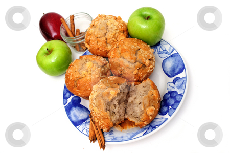 Apples and Muffins stock photo, Apple spice breakfast muffins on a county style blue and white plate with apples and cinnamon spice isolated on a white background by Lynn Bendickson