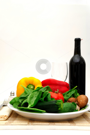 Fresh Veggies stock photo, Assorted vegetables including spinach, red and yellow bell pepper, squash and mushrooms served on a single place setting by Lynn Bendickson