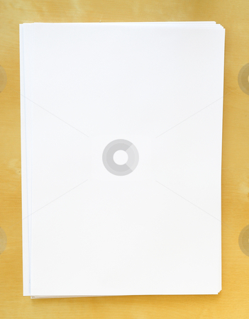 Paper Sheets on the Desk stock photo, White empty Paper Sheets on the wooden Desk by Mehmet ali Ertek