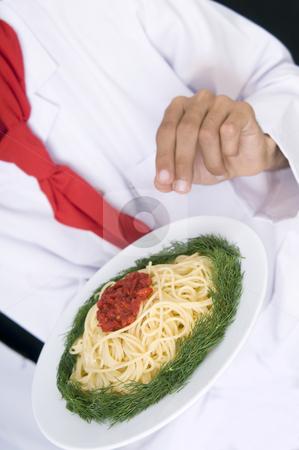Chef Preparing spaghetti stock photo, Chef Preparing spaghetti by Mehmet ali Ertek