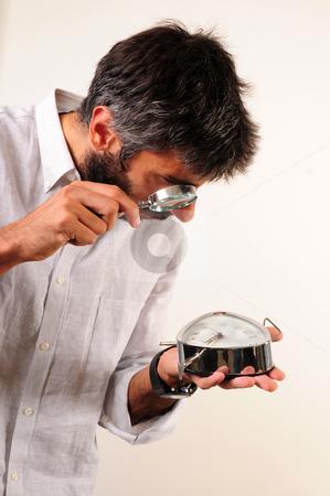 What time is it stock photo, What time is it. Man looking to clock by Mehmet ali Ertek