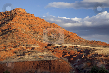 Eroded red mountain with sparse vegetation stock photo, Red Mountain Open Space semi desert landscape in northern Colorado near Wyoming border, autumn scenery by Marek Uliasz