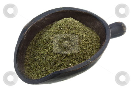 Scoop of dried dill weed stock photo, Dried dill weed on a rustic wooden scoop isolated on white by Marek Uliasz