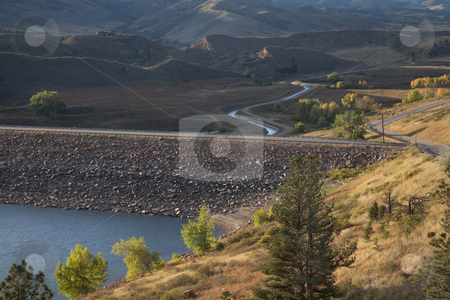 Rock dam on mountain reservoir in Colorado stock photo, Rock dam on Horsetooth Reservoir at foothills of Rocky Mountains near Fort Collins, Colorado, Charles Canal below the dam is running water, early fall by Marek Uliasz