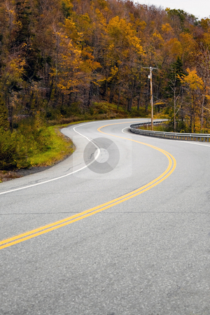 New England Road stock photo, A curved New England road during the fall with bright foliage. by Todd Arena
