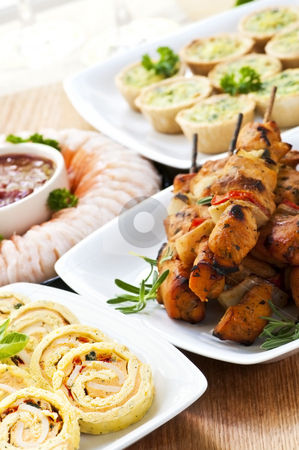 Assorted appetizers stock photo, Many dishes of bite size appetizers and party food by Elena Elisseeva