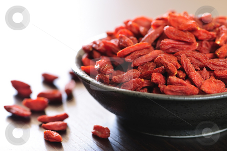 Goji berries stock photo, Full bowl of red dried goji berries by Elena Elisseeva