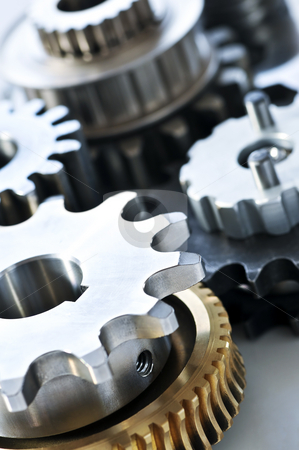 Gears stock photo, Industrial metal gears and machine parts connected by Elena Elisseeva