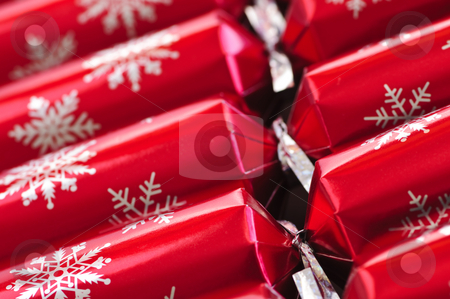 Christmas crackers stock photo, Closeup of many red Christmas crackers in a row by Elena Elisseeva