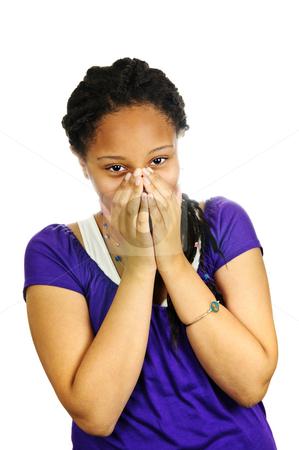Teenage girl stock photo, Isolated portrait of beautiful black teenage girl covering mouth by Elena Elisseeva