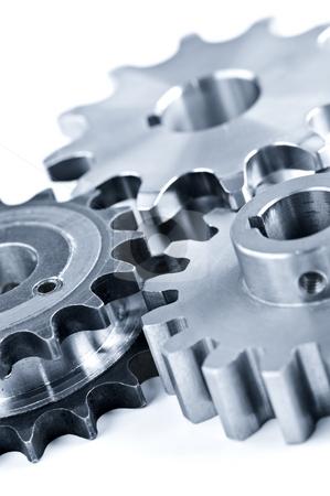 Gears stock photo, Interlocking industrial metal gears isolated on white by Elena Elisseeva