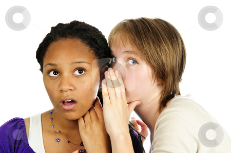 Two girlfriends gossiping stock photo, Isolated portrait of two diverse teenage girl friends gossiping by Elena Elisseeva